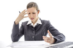 Frustrated woman at office table Stock Images