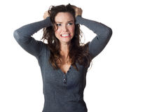 Frustrated woman pullinh ger hair Royalty Free Stock Image