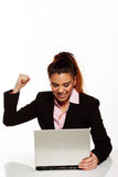 Frustrated woman punching her laptop Royalty Free Stock Photos