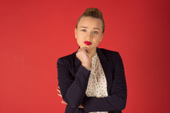 Frustrated woman. On a red background Stock Photos