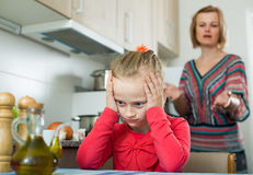 Frustrated woman scolding little girl Royalty Free Stock Photo