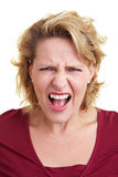 Frustrated woman screaming. Loudly into the camera Stock Photos