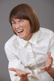 Frustrated woman screaming. In the camera Royalty Free Stock Image