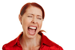 Frustrated woman screaming loudly. Frustrated redhaired woman screaming loudly with open mouth Stock Photos