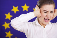 Frustrated woman screaming over european flag. Frustrated woman screaming from stress over european union flag Stock Images