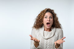 Frustrated woman showing her ignorance. Frustrated attractive fashionable young woman showing her ignorance and bewilderment as she shrugs her shoulders while Royalty Free Stock Photos