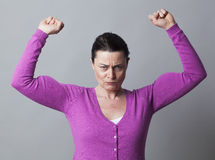 Frustrated woman showing her strong muscles for independence Royalty Free Stock Images