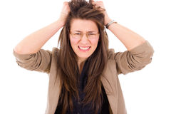 Frustrated woman in stress pulling hair Stock Photo