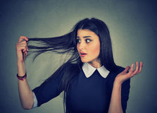 Frustrated woman surprised she is losing hair, receding hairline Stock Photography