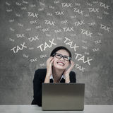 Frustrated woman with tax words Stock Photography