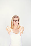 Frustrated woman with thumb down Royalty Free Stock Photos