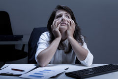 Frustrated woman trying to read diaphragm. During work Stock Photos