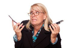 Frustrated Woman with Two Cell Phones Stock Photo