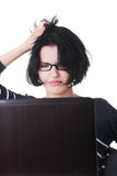 Frustrated woman working on laptop Royalty Free Stock Photo