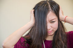 Frustrated woman. Young woman holding her head looking frustrated Royalty Free Stock Photo