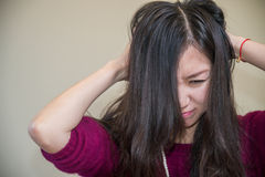 Frustrated woman. Young woman holding her head looking frustrated Stock Photography
