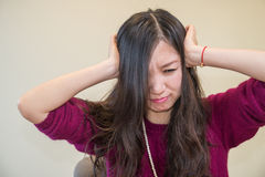 Frustrated woman. Young woman holding her head looking frustrated Royalty Free Stock Images