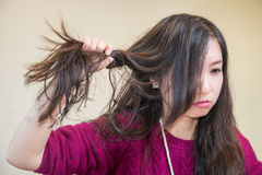 Frustrated woman. Young woman pulling her hair looking frustrated Stock Photography