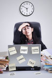 Frustrated worker with clock having problems Royalty Free Stock Images