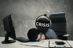 Frustrated worker with crisis word on bomb Royalty Free Stock Photos