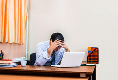 Frustrated worker in the office. The failure and collapse of the business. The businessman has made a mistake Stock Image