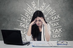 Frustrated worker paying her tax royalty free stock photo