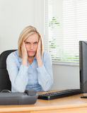 Frustrated working woman looking into camera Royalty Free Stock Photo