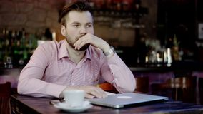 Frustrated young business man in a bar stock footage