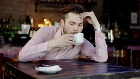 Frustrated young business man in a restaurant stock video footage
