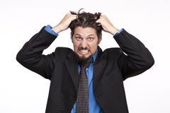 Frustrated young businessman pulling his hair Royalty Free Stock Photo