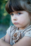 Frustrated young child sulking with crossed arms Royalty Free Stock Photos