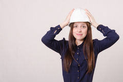 Frustrated young girl put her hands on his helmet Stock Image