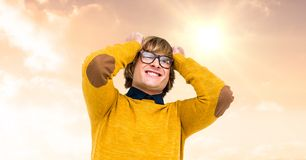 Frustrated young man with hand in head standing against cloudy sky Royalty Free Stock Photo
