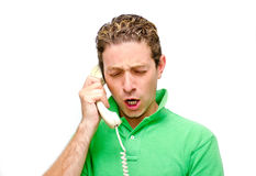 Frustrated young man on the phone. Angry, furious or frustrated guy yelling on the phone Royalty Free Stock Photos