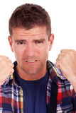 Frustrated young man shows fists Royalty Free Stock Photos