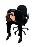 Frustrated young man sitting on chair Stock Images