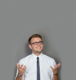 Frustrated young man in white shirt Royalty Free Stock Images