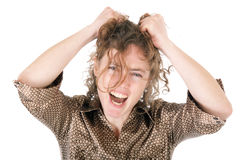 Frustrated young woman. Pulling hairs and crying Stock Image