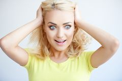 Frustrated young woman with her hands in her hair Stock Photos