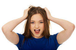 Frustrated young woman screaming. stock photos
