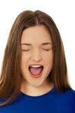 Frustrated young woman screaming. Stock Photography