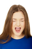 Frustrated young woman screaming. Stock Photo