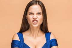 Frustrated young woman screaming at studio Royalty Free Stock Photos