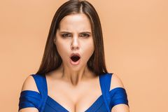 Frustrated young woman screaming at studio royalty free stock images