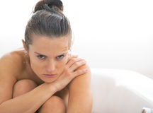 Frustrated young woman sitting in bathtub Stock Images
