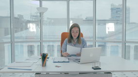 Frustrated young woman trying to work hard. But no good. stock video footage
