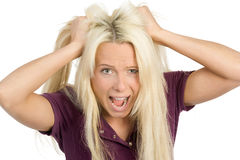 Frustration. Frustated woman tearing her hairs Stock Image