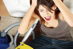 Frustration. Young woman hates cleaning home royalty free stock photography