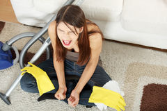 Frustration. Young woman hates cleaning home royalty free stock images