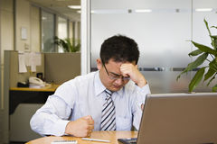 Frustration. Asian business executive shows frustration at work Royalty Free Stock Photos